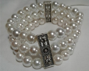 Pearl Bracelet Triple Row with Silver Accent WPJewelry Triple Row Pearl Stretch Bracelet.