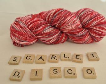 "Hand-dyed yarn, ""Scarlet Disco"" variegated, soft and squishy yarn. Great for socks or shawls. 80/20 Superwash wool/Nylon"