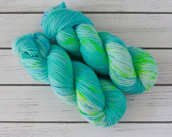 SURFING on a ROCKET - Hand Dyed Speckled Yarn DK weight 3-Ply Superwash Merino Wool in Turquoise Aqua