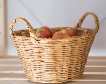 Tall oval vintage handwoven wicker storage basket with handles