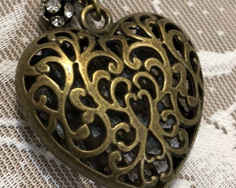 Pendant Necklace  With a Heart.  This necklace is Antique Bronze Tone.