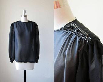 1970s vintage black sequin shoulder long sleeve button cuff sheer top shirt blouse s m