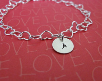 heart charm bracelet with personalized initial charms