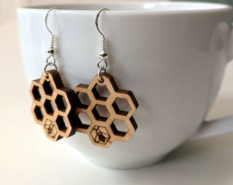Honeycomb earrings, laser cut from wood, with a little bee