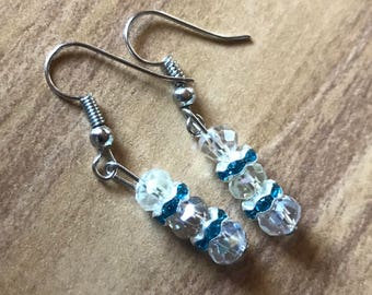 White and blue earring