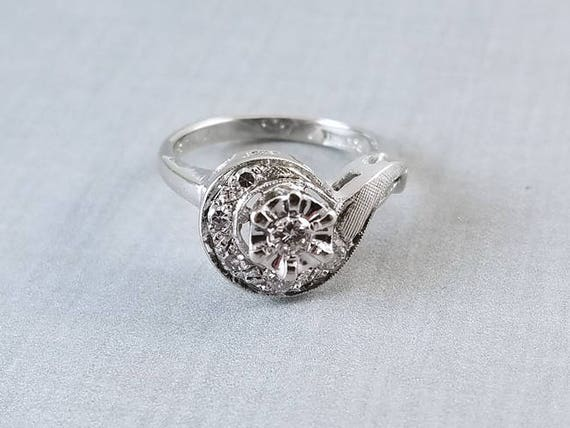Vintage mid century 14k white gold .15 carat diamond halo swirl ring, size 5, signed Portrait