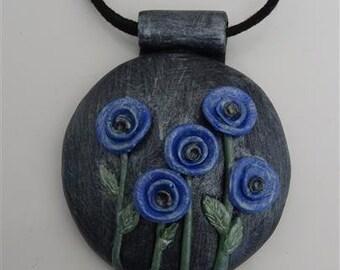 Small blue poppy polymer clay pendant