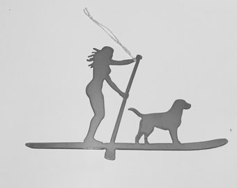 Paddle boarder w dog is available in a male and female version in an ornament or magnet