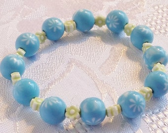 Blue and green stretch cord bracelet