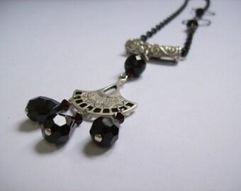 Black and ruby  teardrop necklace. Swarovski ruby crystals.