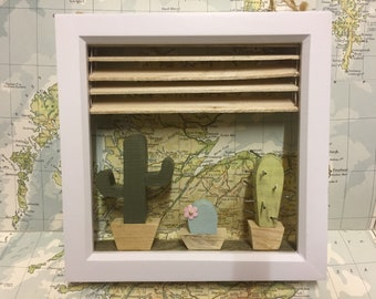 Wooden cactus's in a framed wooden window
