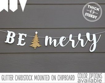 BE merry banner, with christmas tree, christmas decorations, glitter party decorations, cursive banner