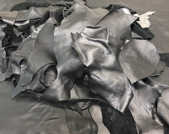 Black Full Grain Leather Scraps and Trimmings: 1-2 lbs in scrap include various finishes/prints in Jet Black cowhide.