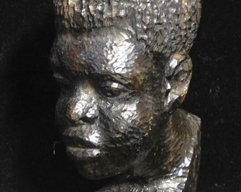 Sensitive wood carving of African man