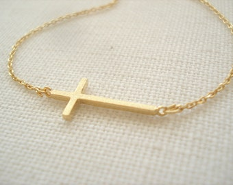 Tiny gold sideways cross charm necklace..simple everyday, faith, religious, celebrity inspired, bridal jewelry, wedding, bridesmaid gift