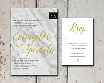 Elegant 2 piece wedding invitation suite with a marble background and an elegant cursive font.