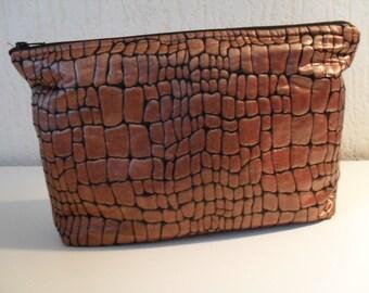 Fabric Faux Croc Clutch has zip closure