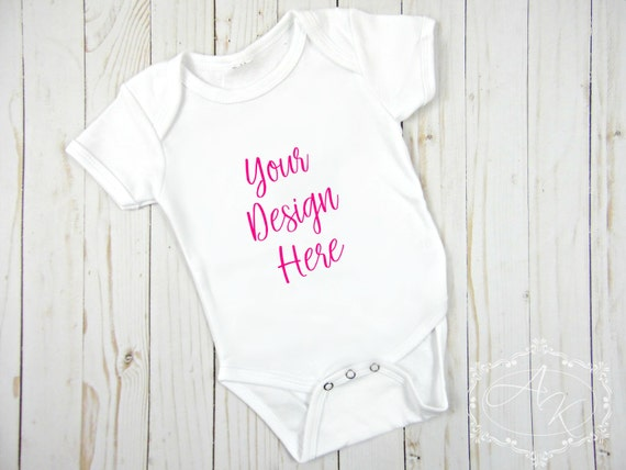 blank white baby onesie product mock up styled product