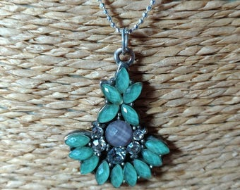 Silver necklace with a blue charm