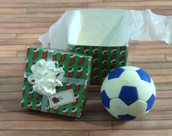Miniature Soccer Ball in a Green Gift Box with a white bow on top