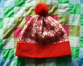 Colourful geometric knitted 'Network' faces design hat with pom-pom. Red and white lambswool hat.