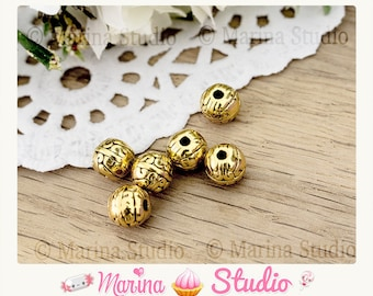 10 Gold 8mm beads with etched effect MS34522