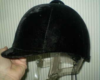 Black Velvet International Riding Helmet with back bow- 1995 helmet with adjustable clear chin strap- top button, plain front, chin snap