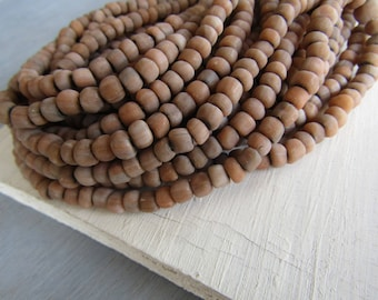 Brown grey glass seed beads , small rustic ethnic spacer , irregular tube barrel indonesia new Indo-pacific 4 to 6mm (22 inch strd) 7ab58-2