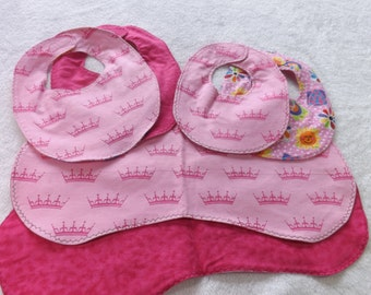 newborn baby bib and burp cloth gift set made from Pink princess crown flannel with coordinating backings