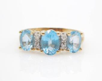 14K Yellow Gold Blue Topaz Three Stone Ring with Diamonds