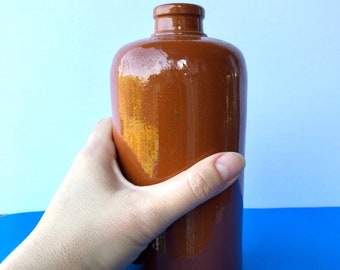 Vintage .7 litre yellow rust crockery bottle