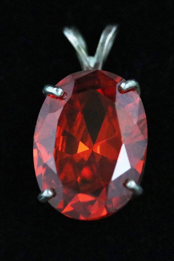 Padparadsha Sapphire Pendant, 4 prong silver bezel 39.5ct