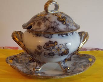New listing........A very old soup tureen with lid and base plate.