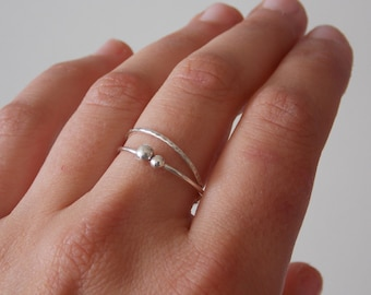 Silver ring for woman.  fine and modern hammered ring with 2 interlace rings.