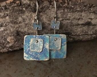 Rustic silver earrings, riveted textured layers, blue ink earrings