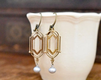Earrings style art deco openwork antique brass filigree with silver gray freshwater pearls