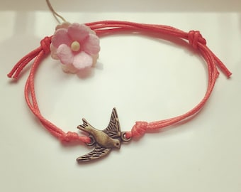 Small swallow - swallow charm on a bracelet in salmon, waxed cotton, vintage, statement, blogger,