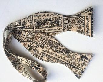 Legend of Z Bow Tie, Handmade from Licensed Legend of Zelda Fabric. Tan with Black line drawings of computer game adventures