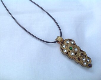 This pendant made of paper is golden, decorated with Strass and varnished.