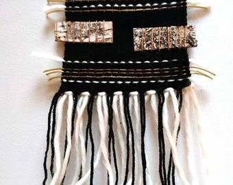 Small black woven wall hanging