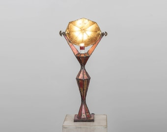 "Red ""L2"" brass lamp"