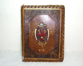 """Leather stationary folder, writing center with nylon lined pouches. and a pen or pencil slip. .6"""" wide, 73/4"""" tall. Embossed Fleur de Lis"""