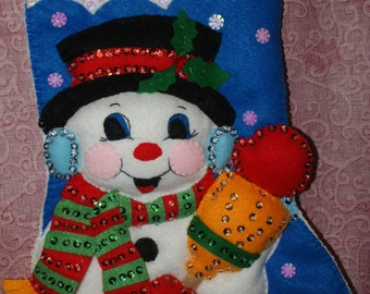 handcrafted felt snowman with broom stocking