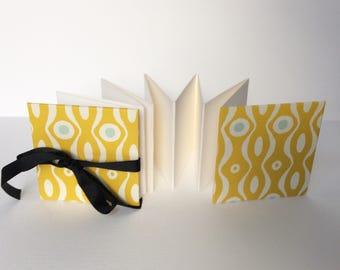 Mini accordion photo album - mustard and teal wavy line covers