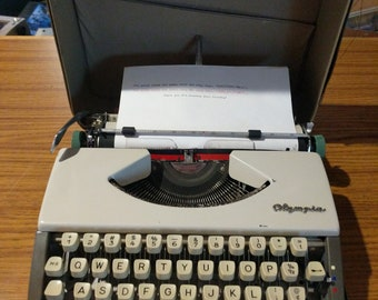 1962 Olympia SF ultra portable typewriter with Script (cursive) font!
