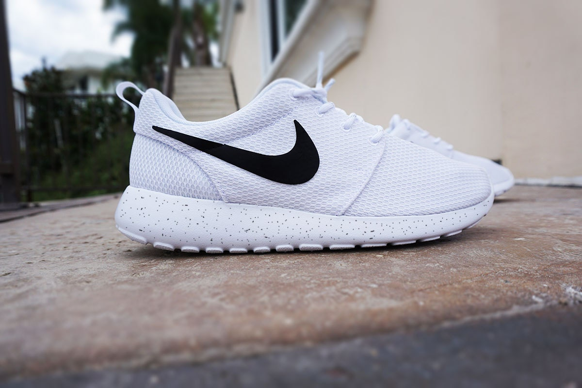 <h2>black nike shoes for women with white swoosh image</h2> <div id=