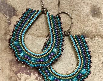 Teal teardrop earrings in brass with purple and blue accents