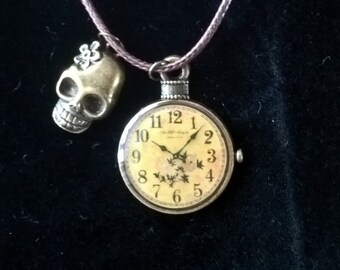clock/skull pendant