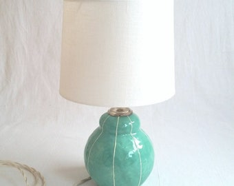 Small ceramic lamp with bird finial. Unique bedside table lamp. White shade. Scandinavian style. Luxury design, home lighting. Kri Kri