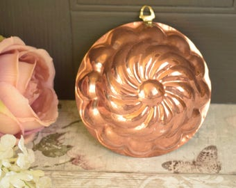 Small vintage copper plated round tin swirl shape mould